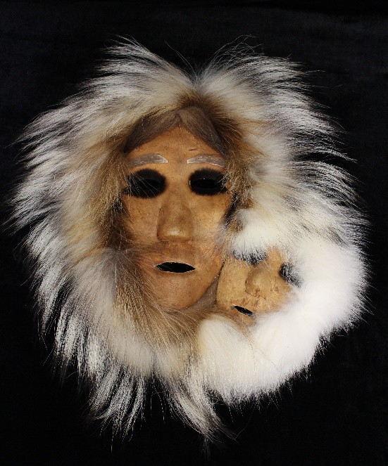 Two masks. Both encompassed by fur.