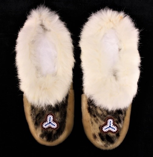 A pair of seal skin and rabbit fur mocccasins.