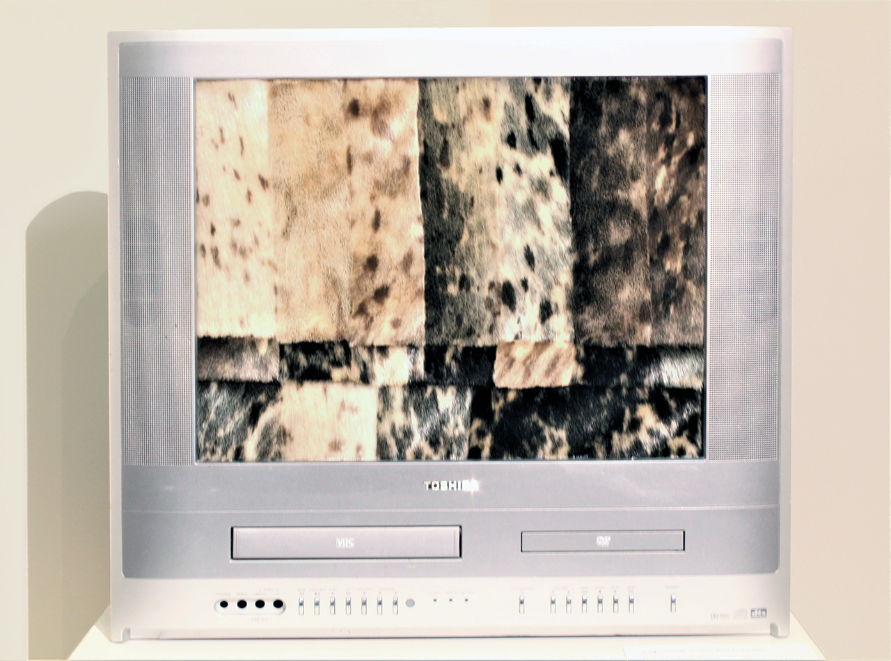 TV with sewn seal fur pieces in place of the screen