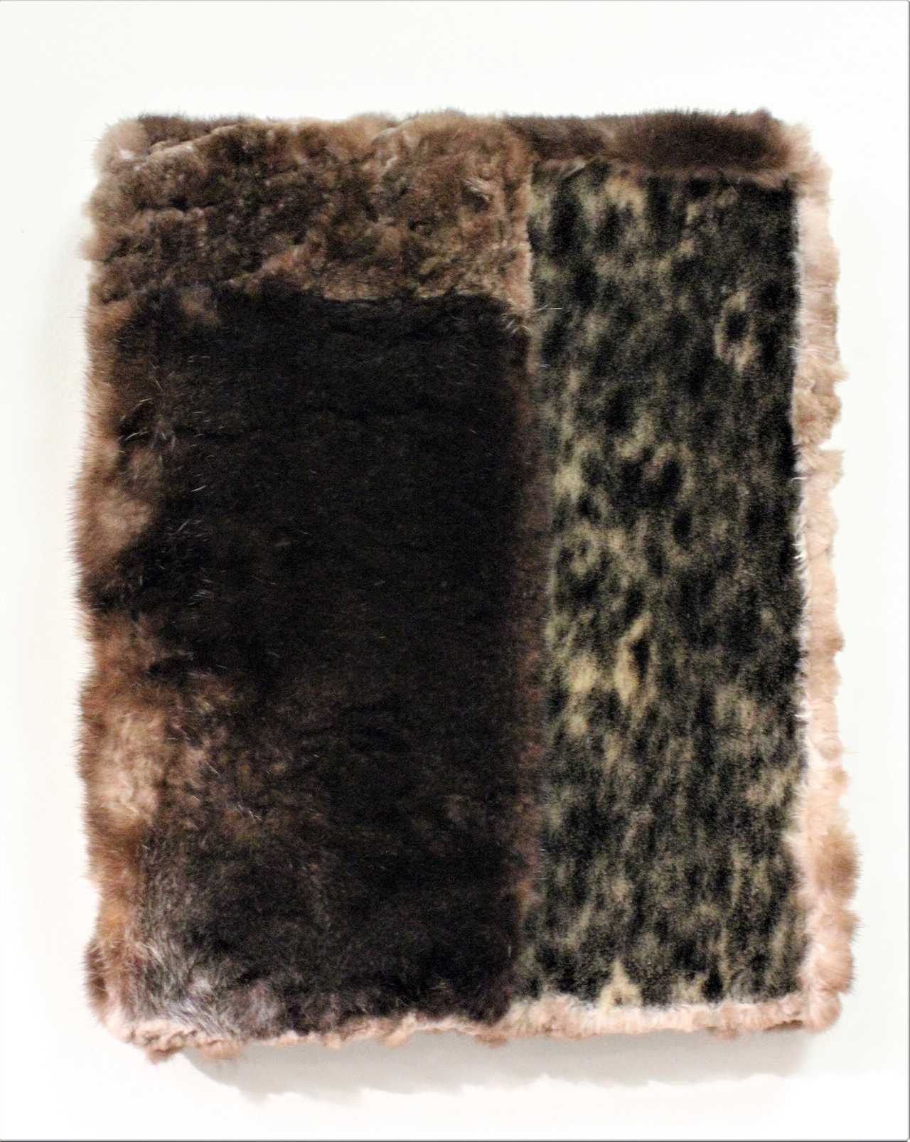 A painting/sculpture made from sea otter and seal fur