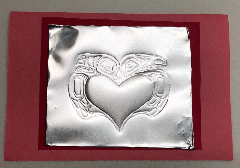 Embossed heart surrounded by Tlingit formline.