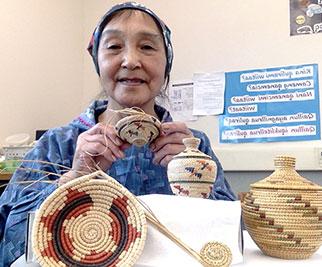 Neva Mathias will some of her baskets