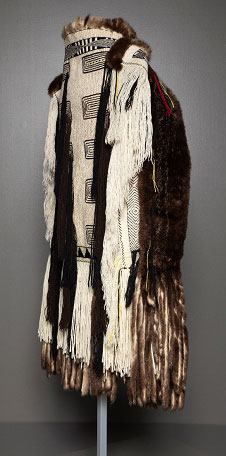 Robe with black and white geometric patterns and dark brown fur.