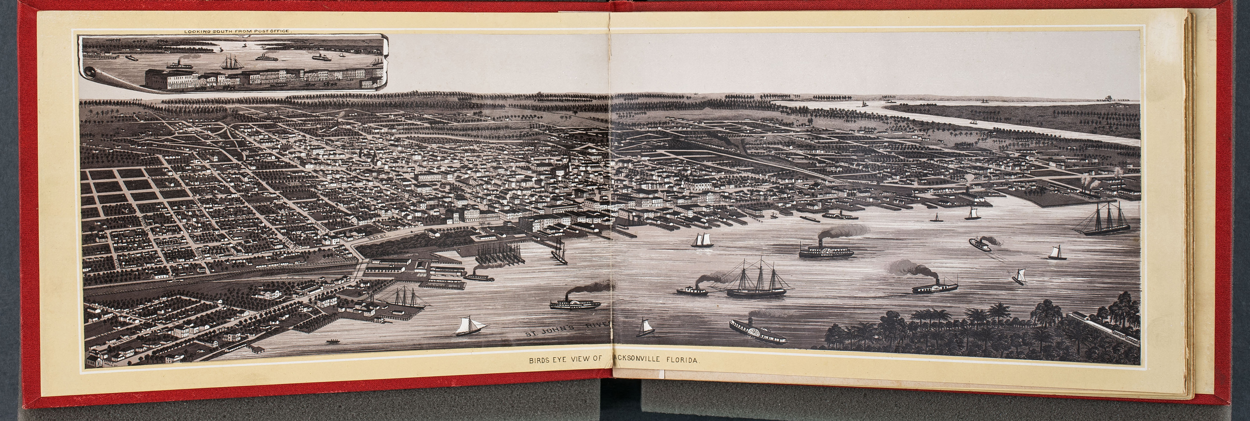 A book open to a page depicting a historic, aerial view of Jacksonville, Florida.