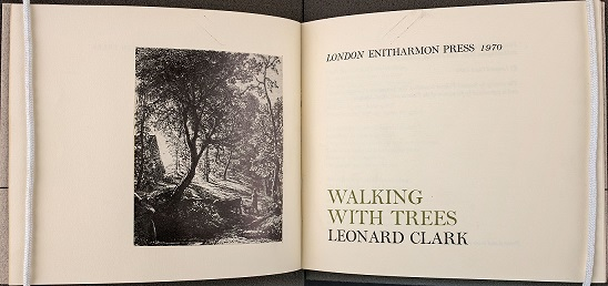 The poetry book Walking With Trees by Leonard Clark.
