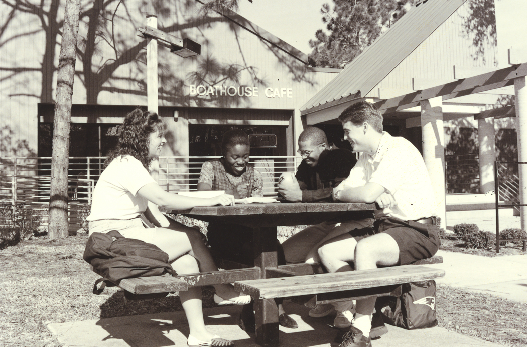 Historic photo of UNF students sitting in front of the former Boathouse Cafe.
