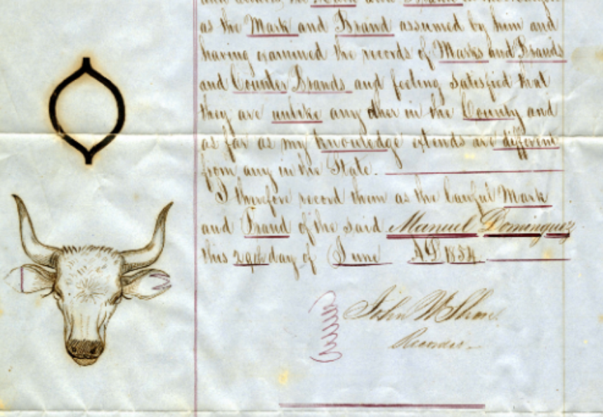 Image of Dominguez Ranch deed with cattle brand.