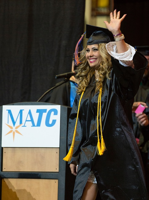 Natalia Dean walks across the stage during her graduation.