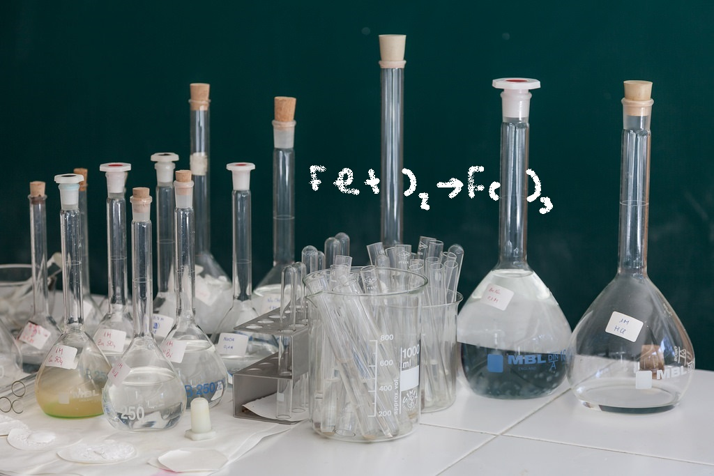 chemistry lab equipment and math equation