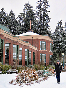 Snowy exterior of the south facade of Knight Library