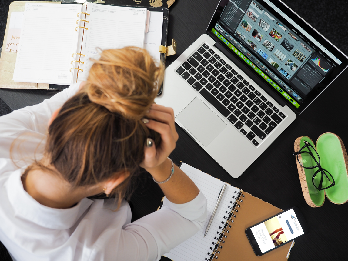 stressed worker in front of a computer