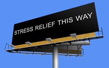 "image of billboard saying ""stress relief this way"""