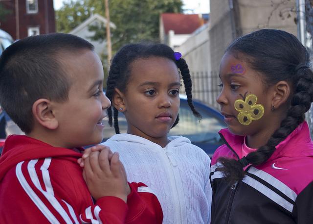 Three kids talking.