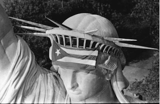 Statue of Liberty with Puerto Rican flag draped over the crown, 1977.