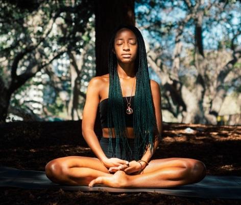 Woman in seated yoga pose.