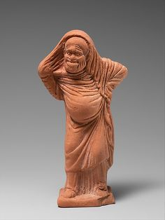 Comic terracotta figurine of woman, link to Aristophanes