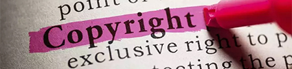 """Pink marker highlights the word """"copyright"""" in a dictionary"""