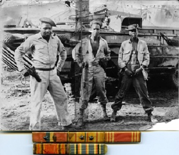 WW2 African American soldiers stand in front of ship