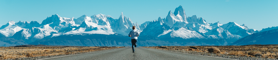 Man running towards mountains