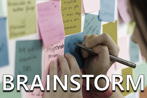 Brainstorm: Person writing on colored sticky notes