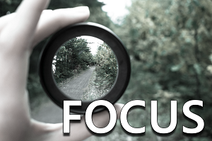 Focus: Person holding a magnifying lens