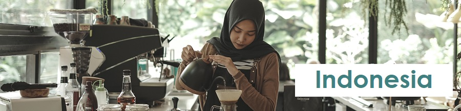 Woman in head scarf pouring coffee