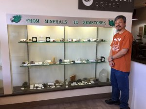Roger Kwok next to his display of minerals