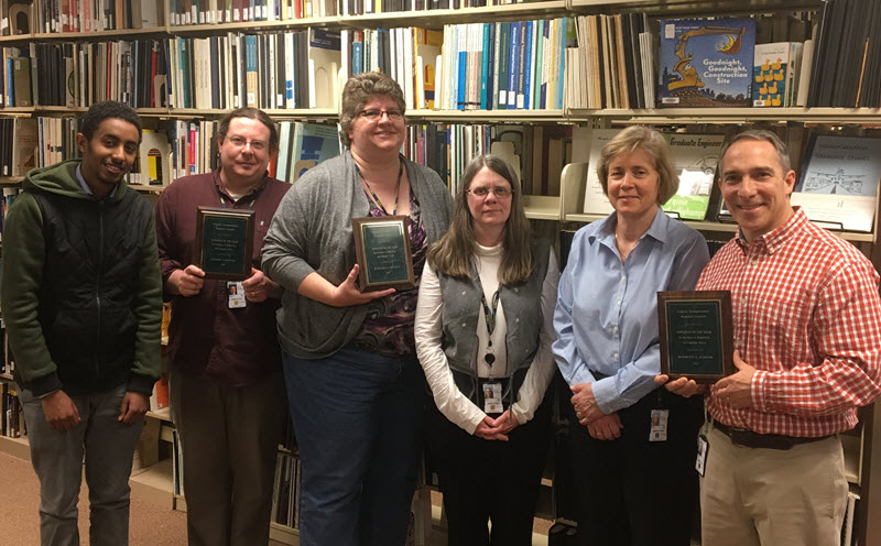 Library staffers (left to right): Haddis Abebe, Gil Kenner, Barb Neyman, Becky Ernest and Ken Winter (with supervisor Dr. Amy O'leary).