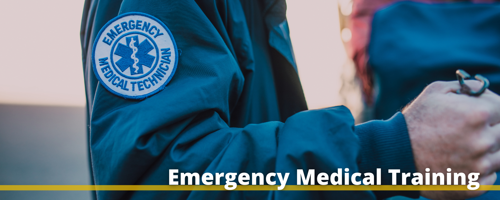 """Image of a person in an EMT uniform with the words """"Emergency Medical Training"""" printed below"""