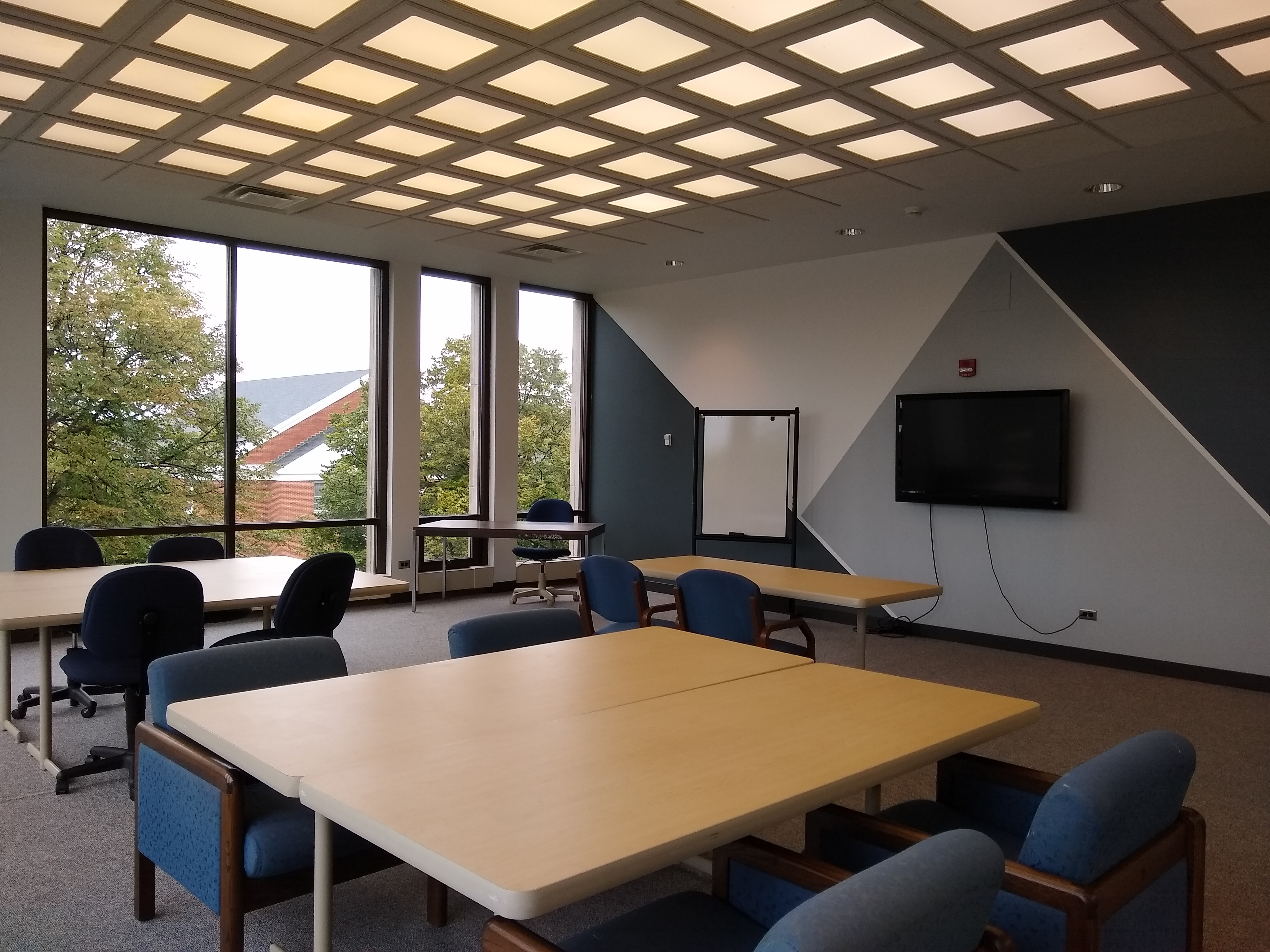 Room 301 features large tables and plenty of natural light.