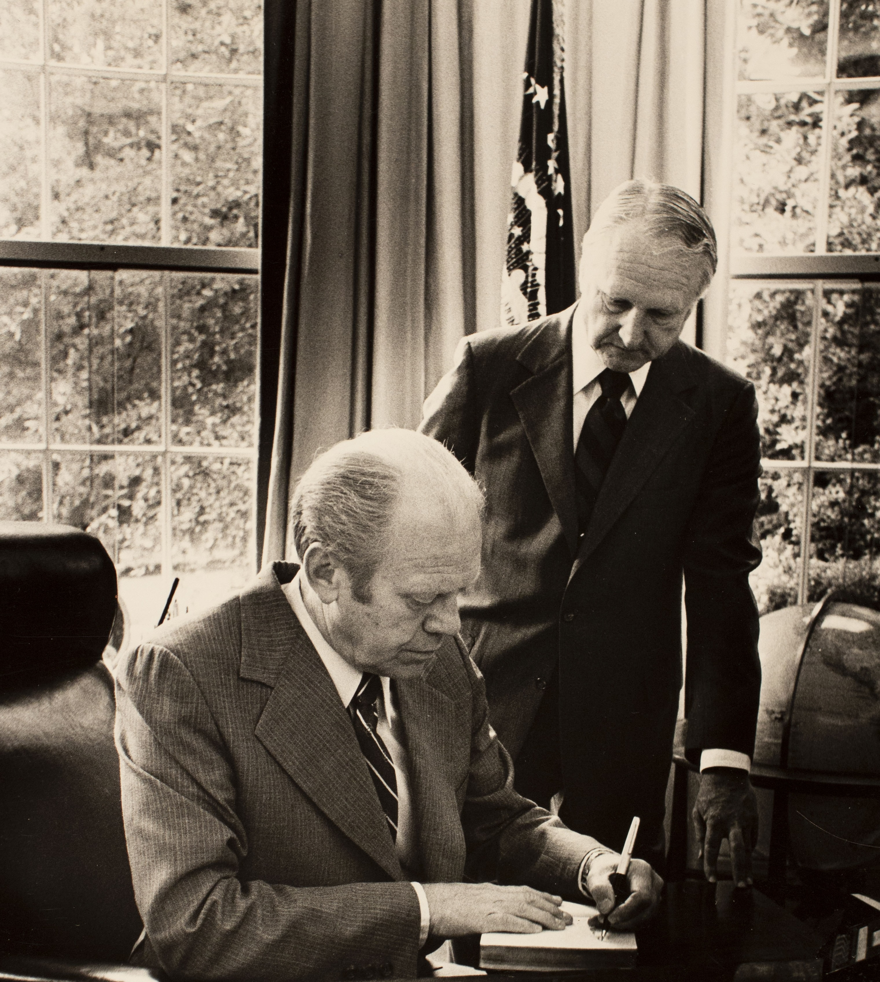 Photograph of President Ford signing the Bible