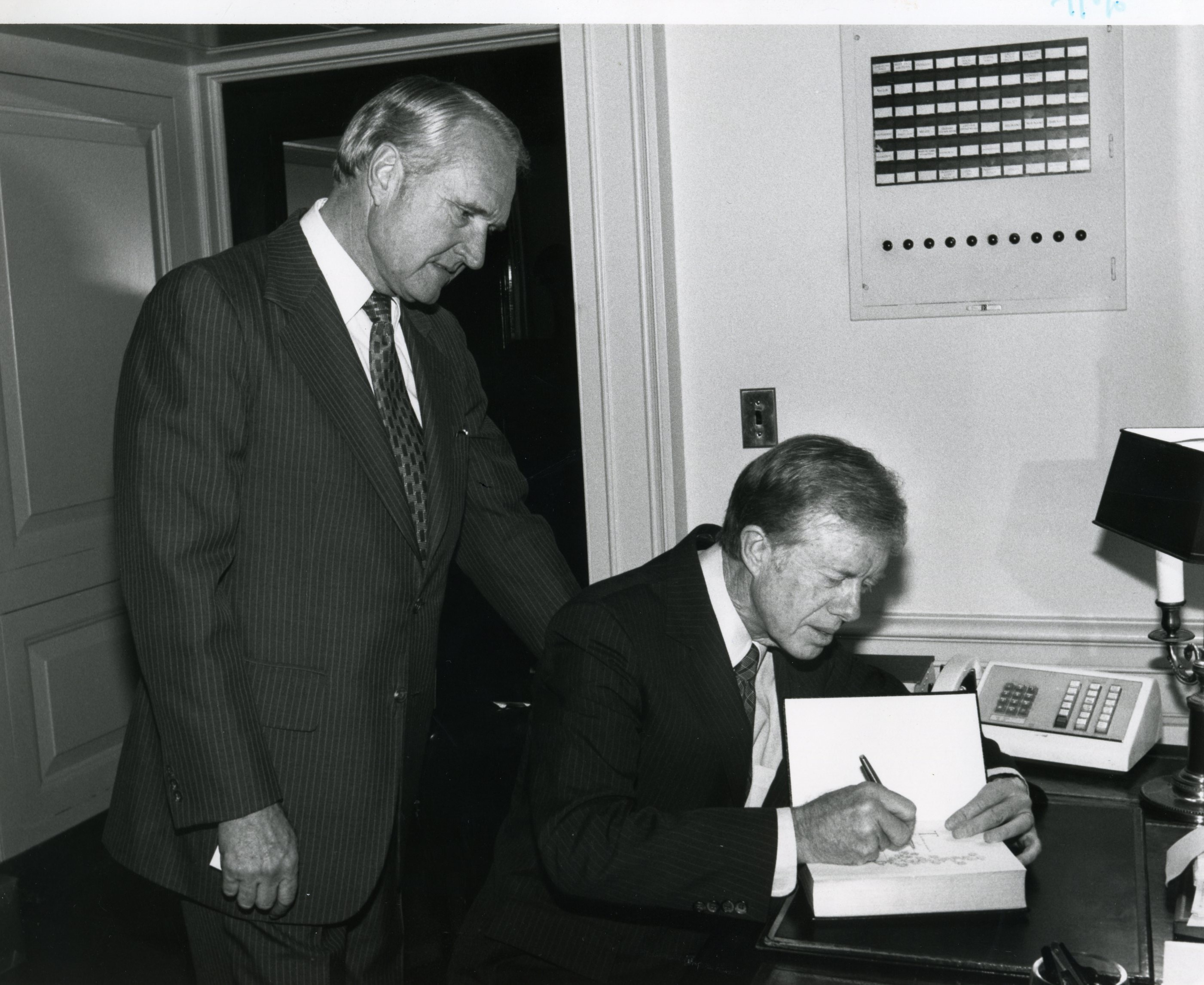 Photograph of President Carter signing the Bible