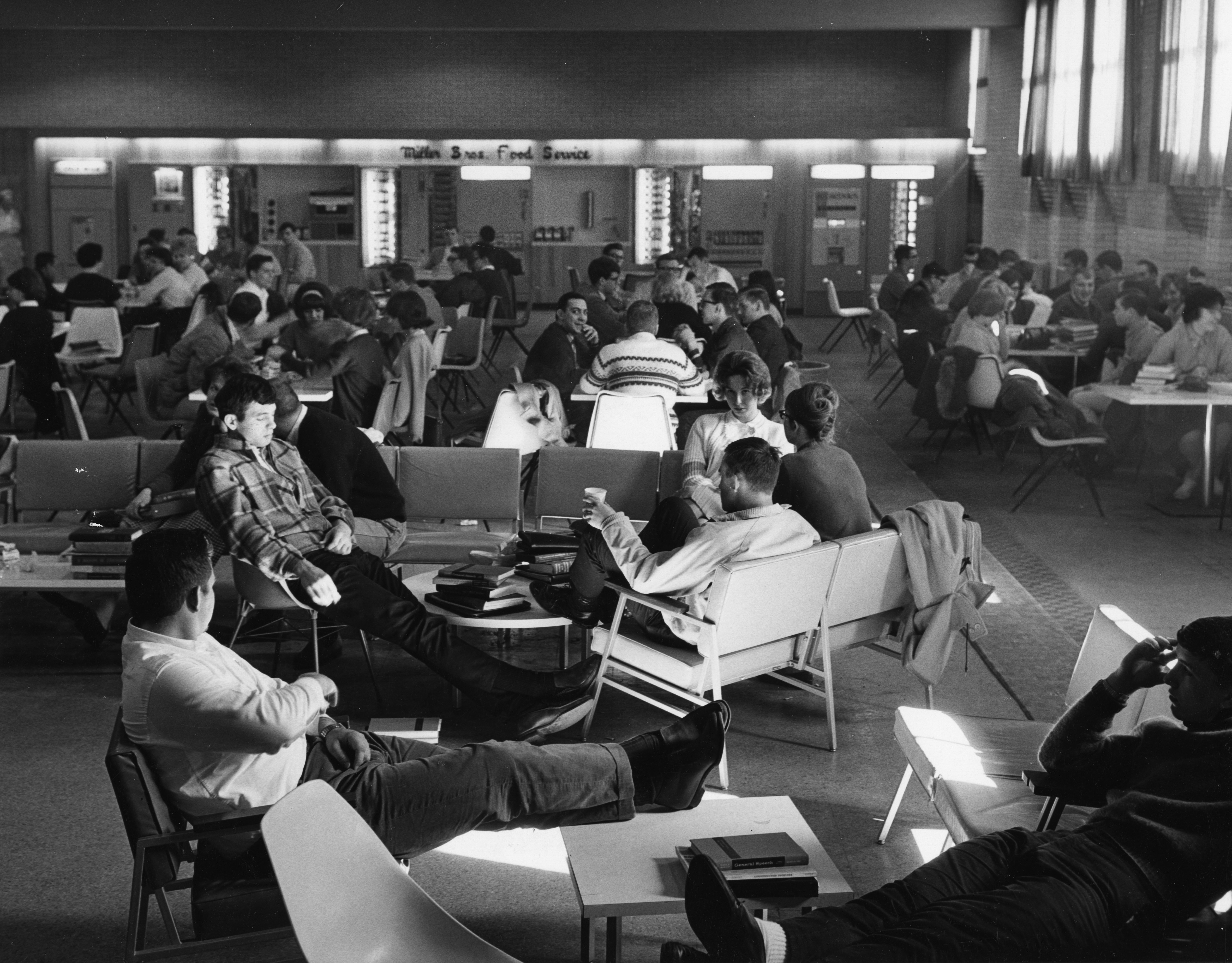 students relaxing in common area