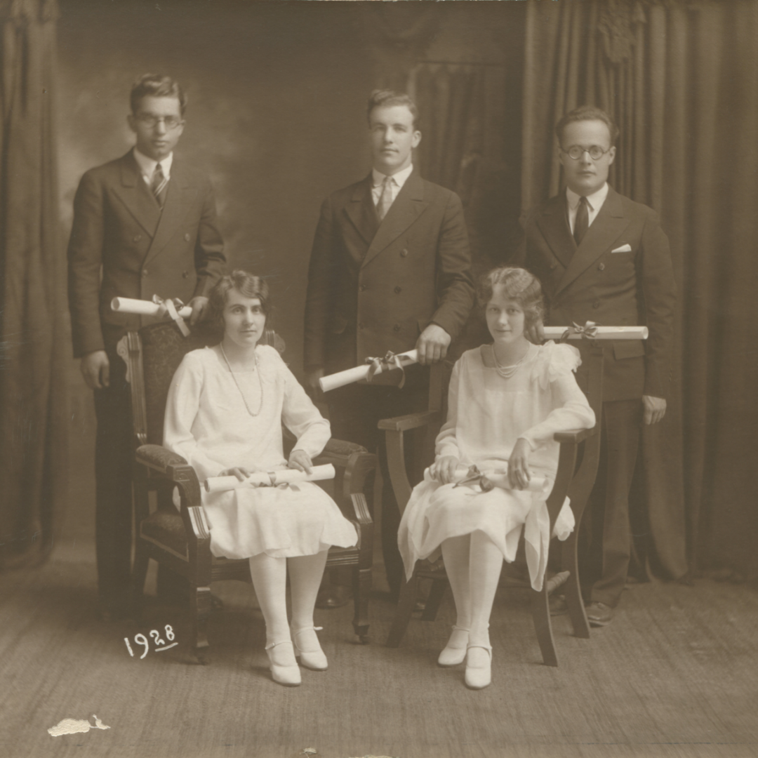 Photo of the Dudley Bible Institute Class of 1928. Three men stand in the back row while two women sit in chairs in the front row.