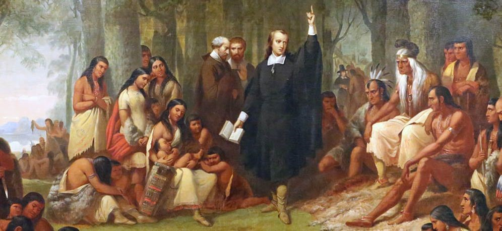 """Painting title """"Eliot's Indian Bible"""" by Elijah M. Haines (1888) showing Eliot preaching to the Natives"""