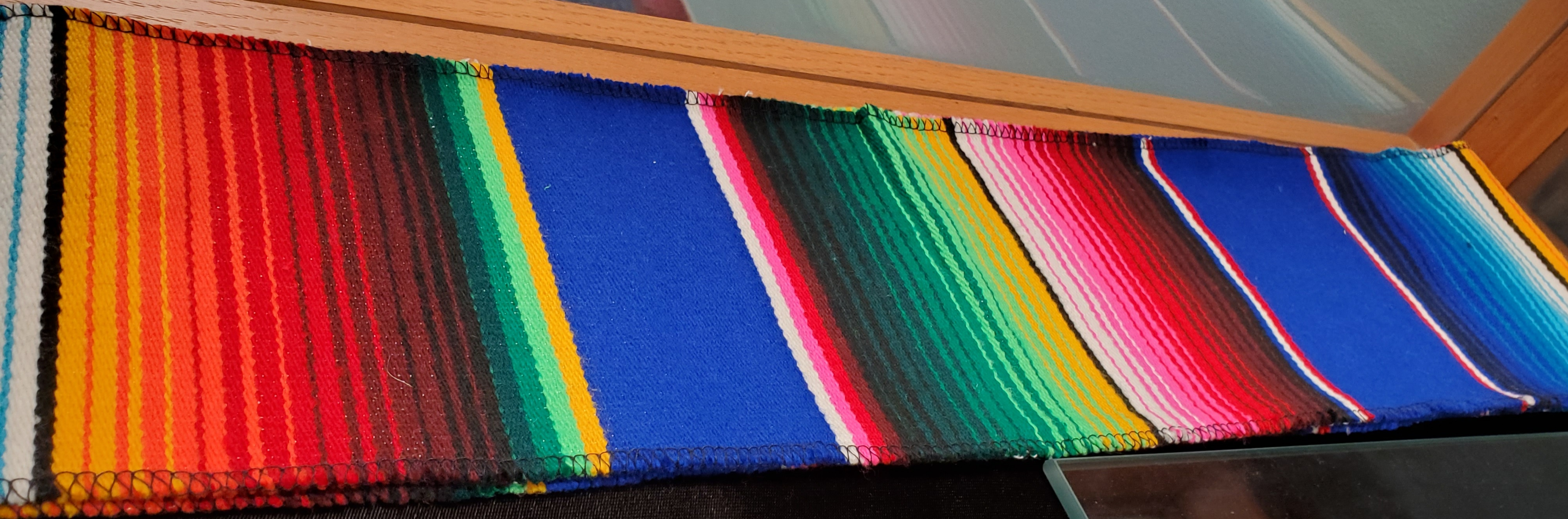 Commencement Sash for students of Hispanic descent. It has stripes of colors in hues of green, blue, pink, white, red, orange, black, and yellow