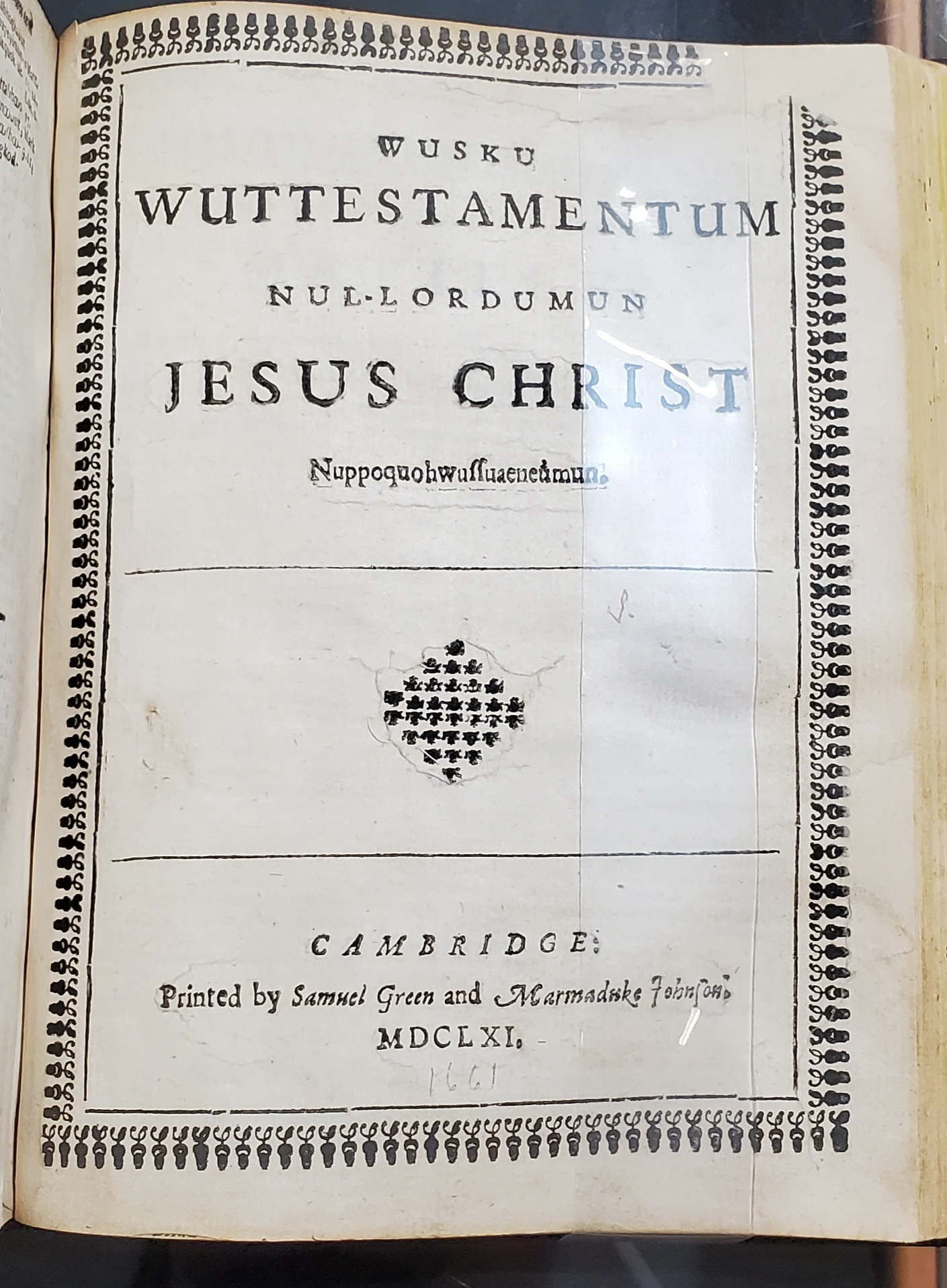Title page of the New Testament in Eliot's Indian Bible. Text is in Algonquian.