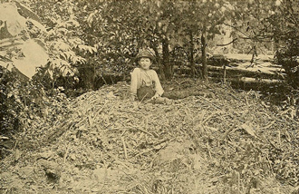 Boy lays on Australian Brush-turkey mound, ca 1899