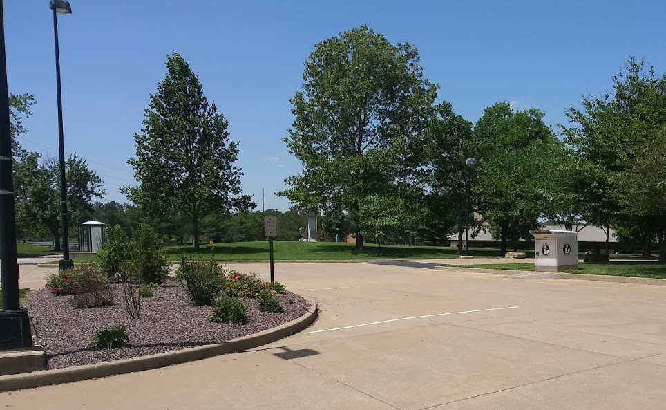 Photo of service parking spots for curbside item pickup at Rice Library semi-circle.