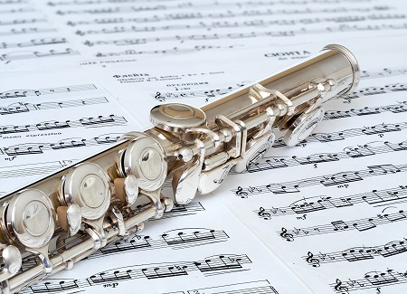 Image of flute with sheet music