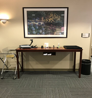 Picture of the library supply table and book drop