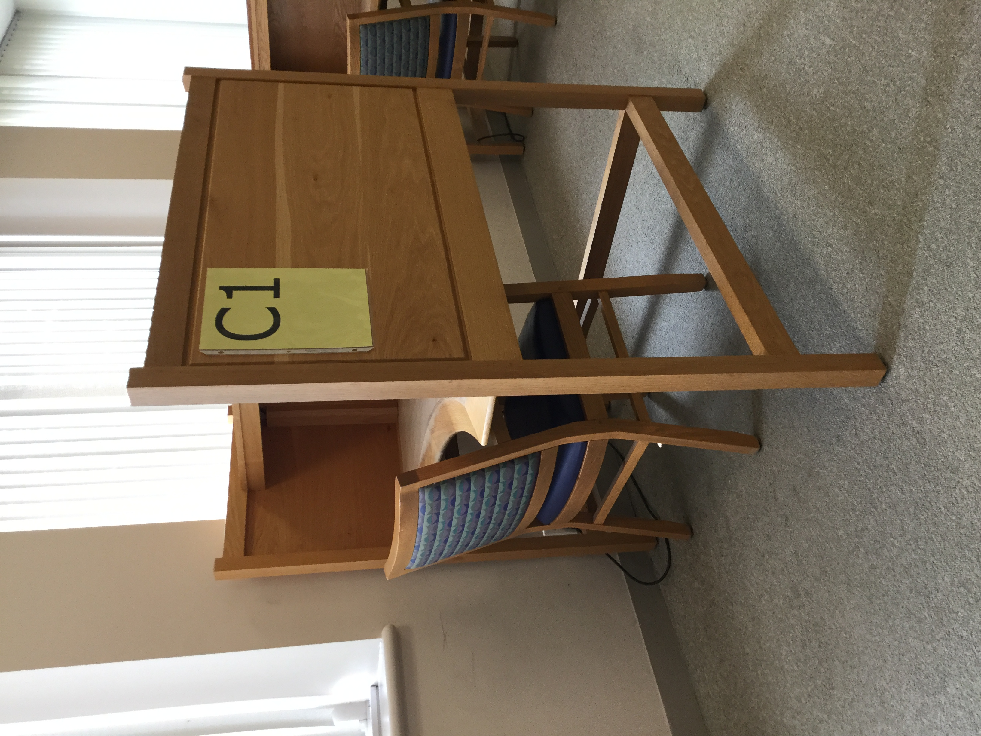 image shows a large study carrel with high sides and a chair, numbered C1