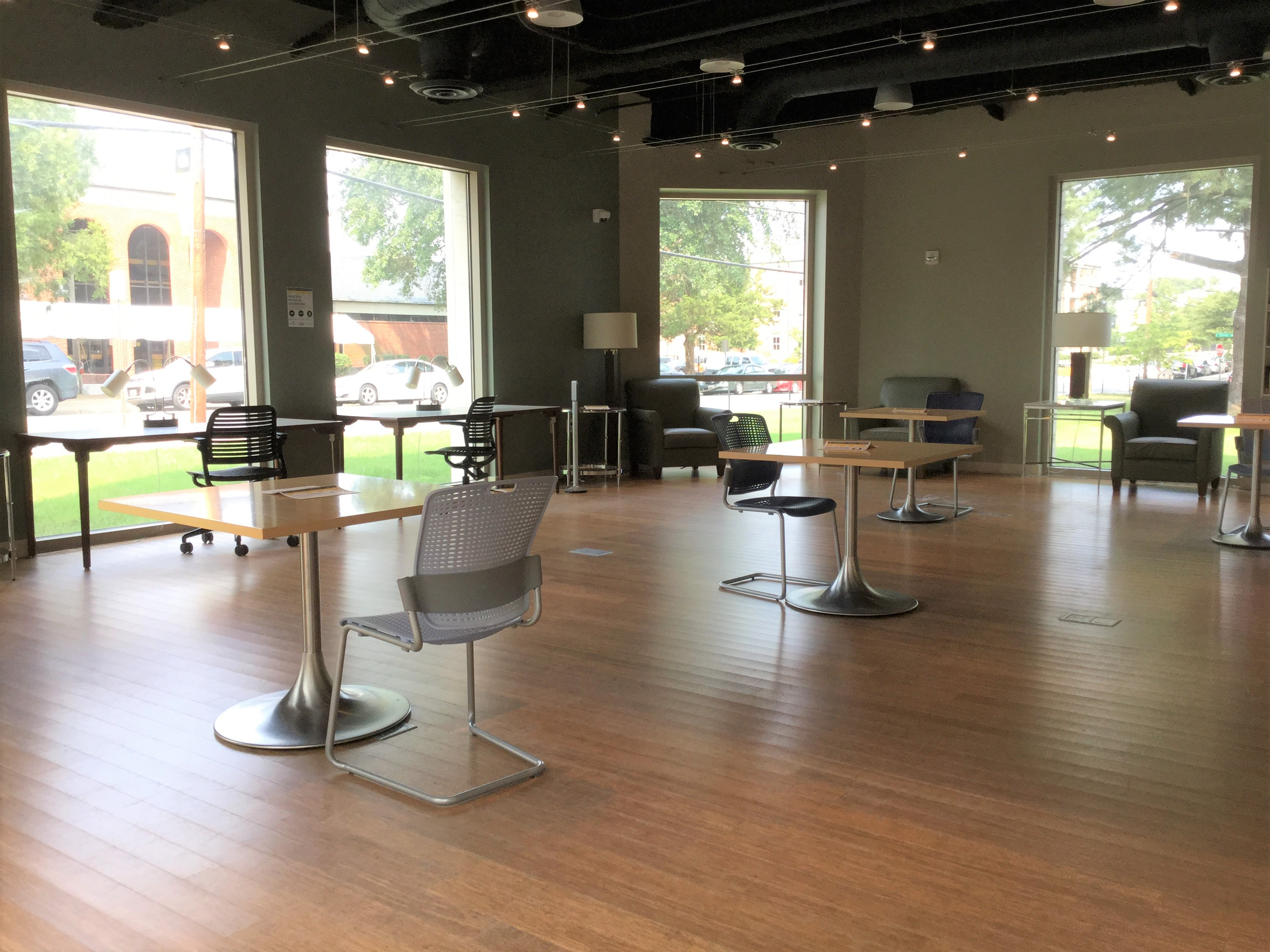 images shows tables and chairs spread out in the abernathy 24/7 study space
