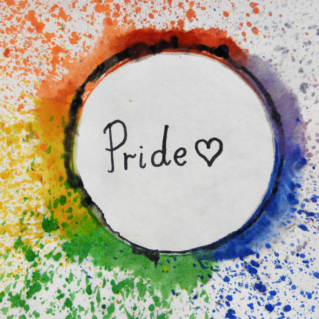 The word Pride in rainbow colored circle with a heart