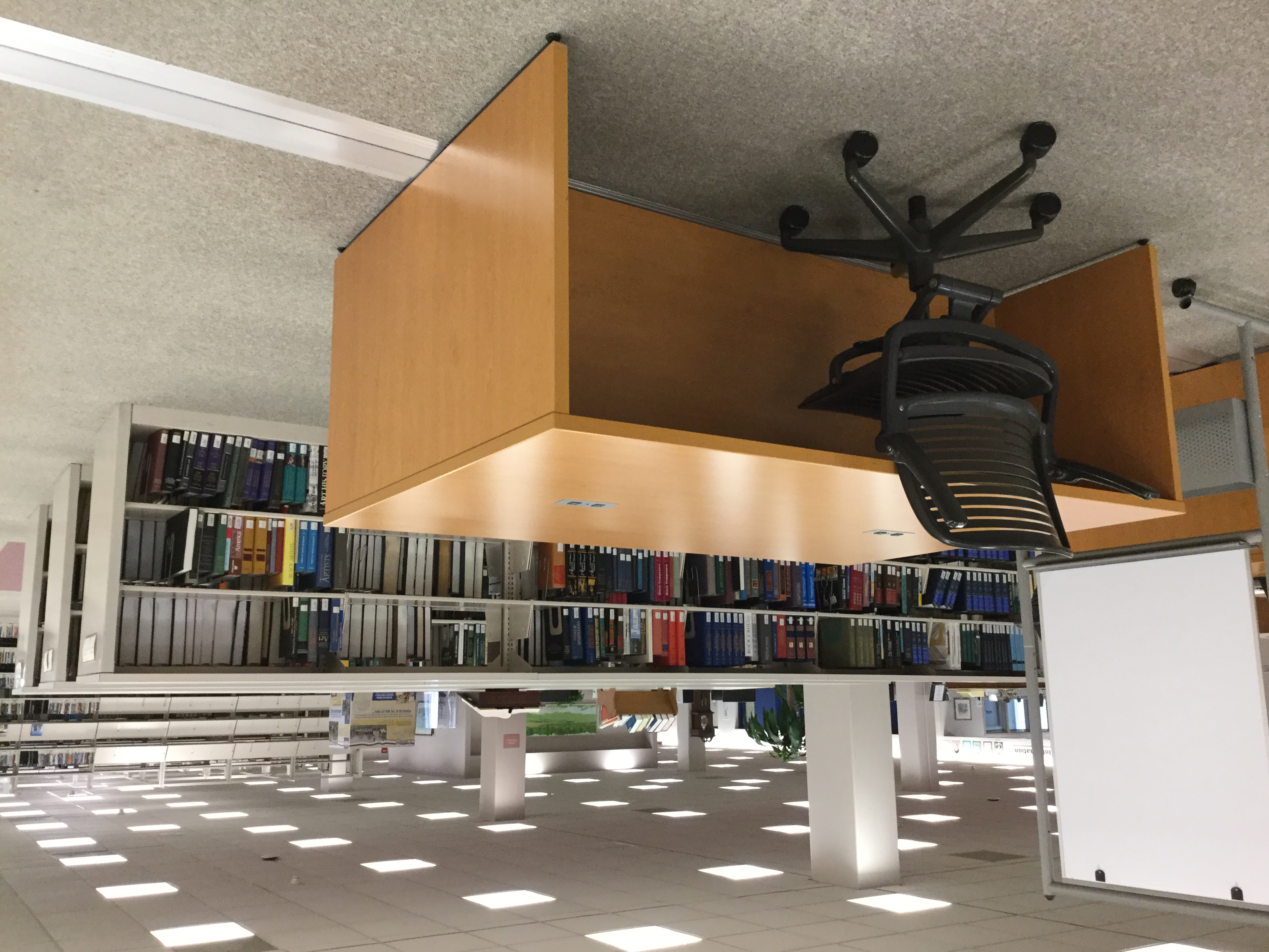 image shows a large table with one chair located on the first floor of the Library