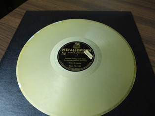 "Gold-colored audio disc wtih ""Metallophon"" label"