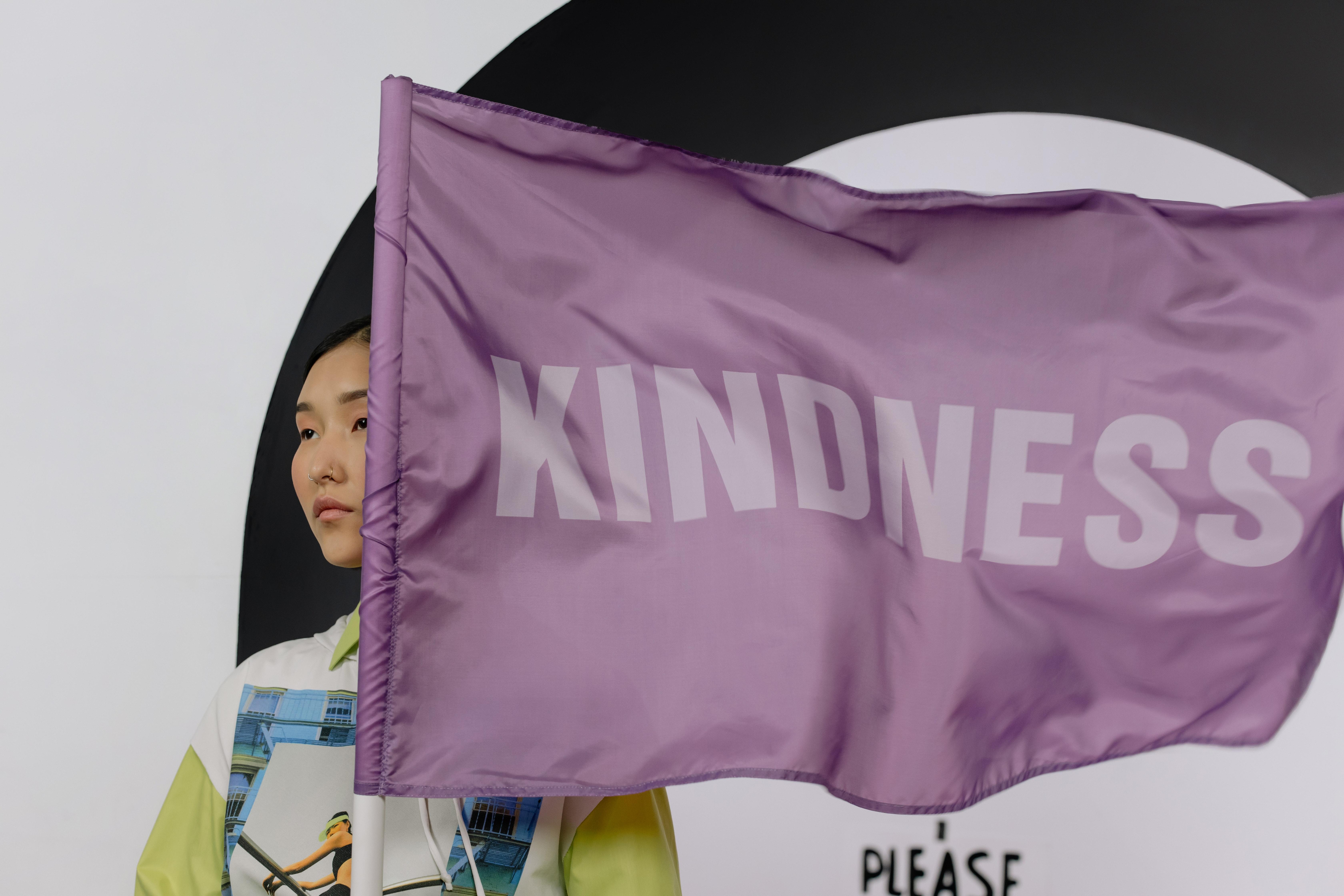 Woman Holding Kindness Flag