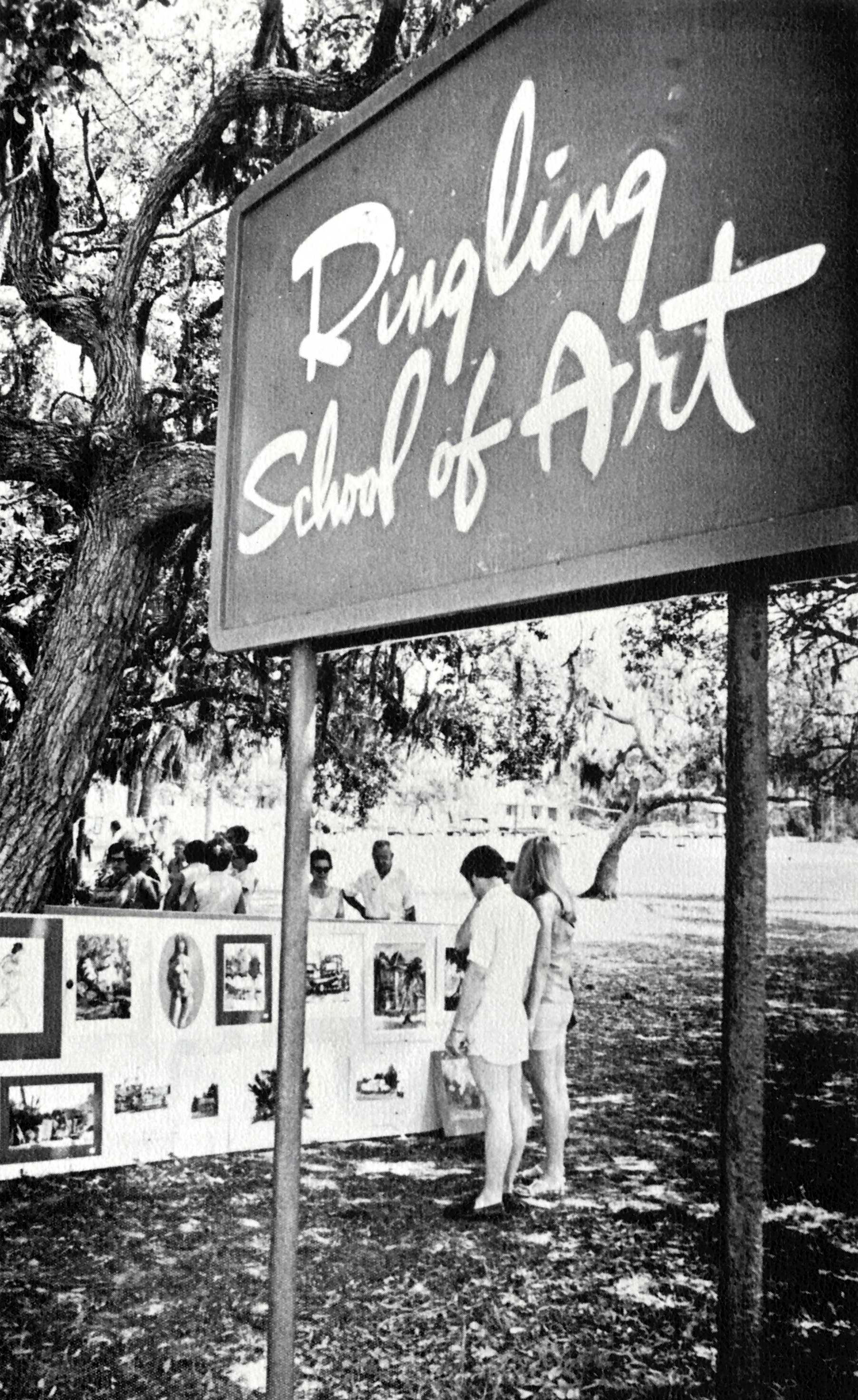 Photo of Ringling School of Art sign in front of annual student sidewalk art sale in 1970