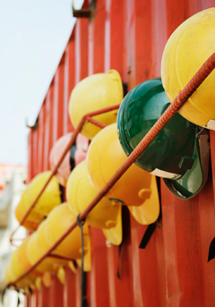 hard hats hanging on wall