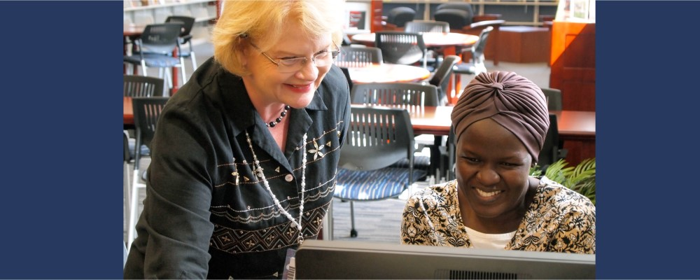SCC Librarian and student working together